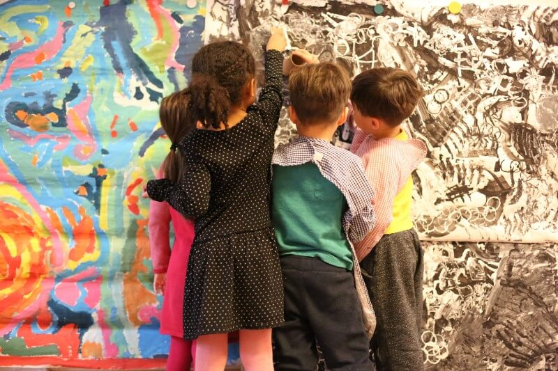 Children painting at school in Brooklyn