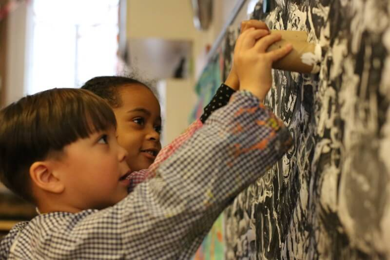 Students learn creativity through drama, drawing, painting, music and movement.